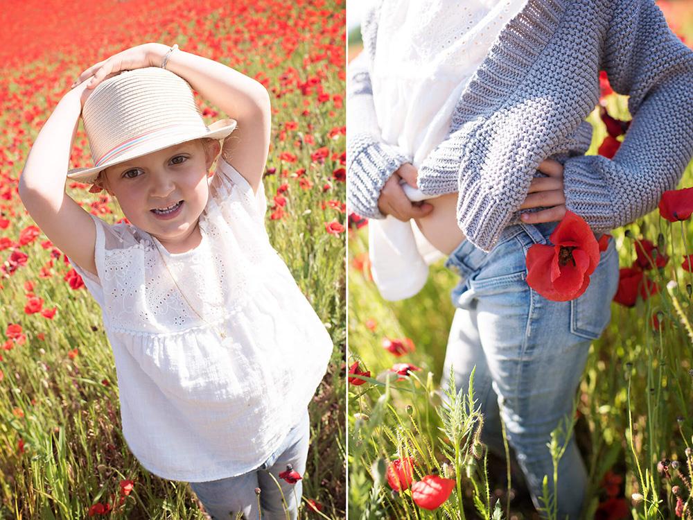 Coquelicot attaché à la ceinture. Portrait d'enfant avec un chapeau de paille.