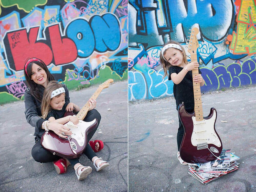 Portrait enfant pas plus haute qu'une guitare électrique.
