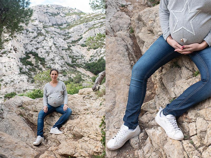 Portrait d'une femme enceinte sur un rocher.